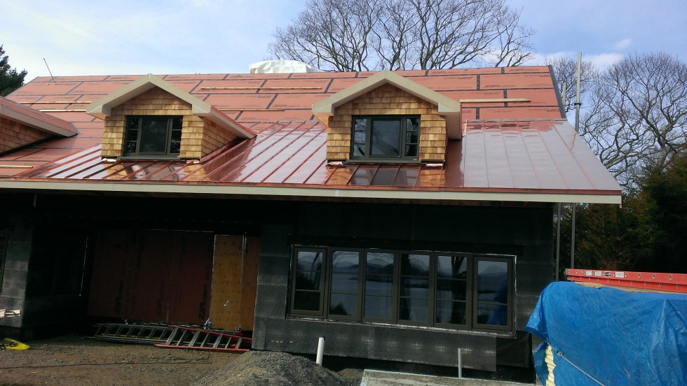 Beginning of the copper standing seam roof